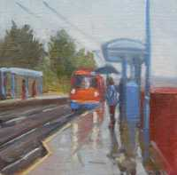 Picture of the Week: <p>Early morning travellers wait for the tram on a wet day behind the railway station.</p>